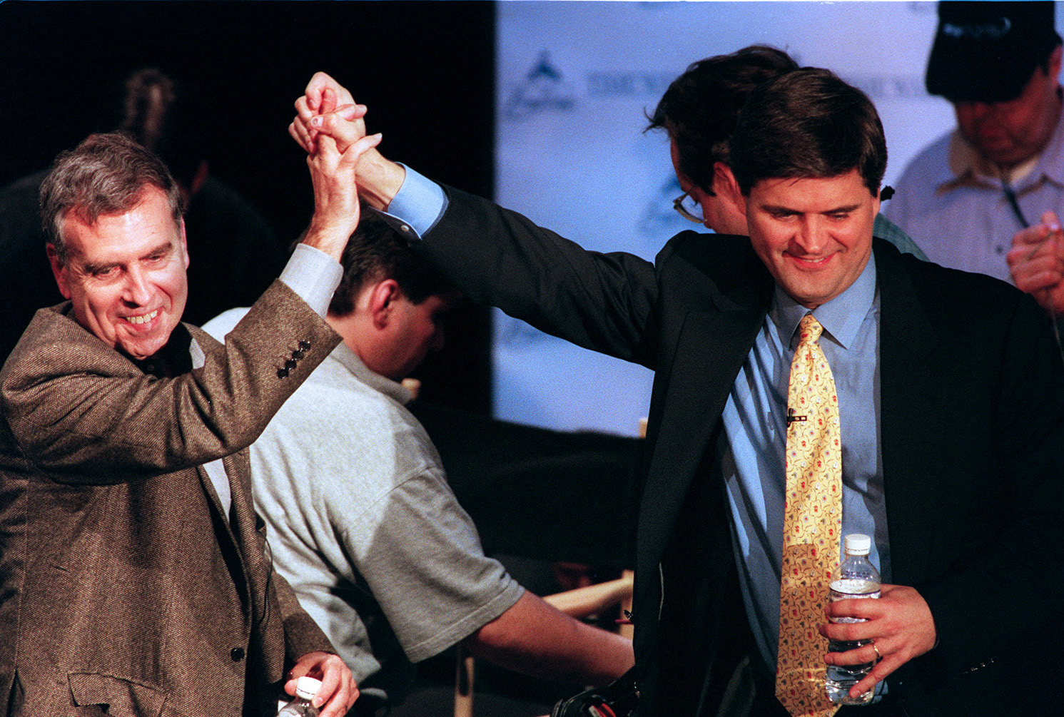 Gerald Levin of Time Warner, left, with Stephen Case of America Online, announcing A.O.L.'s $165 billion deal to acquire Time Warner in January 2000.